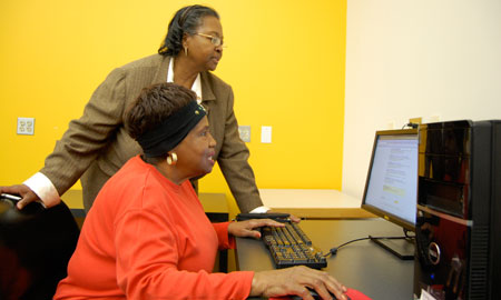 Digital Divide - Senior woman sitting at desktop computer.